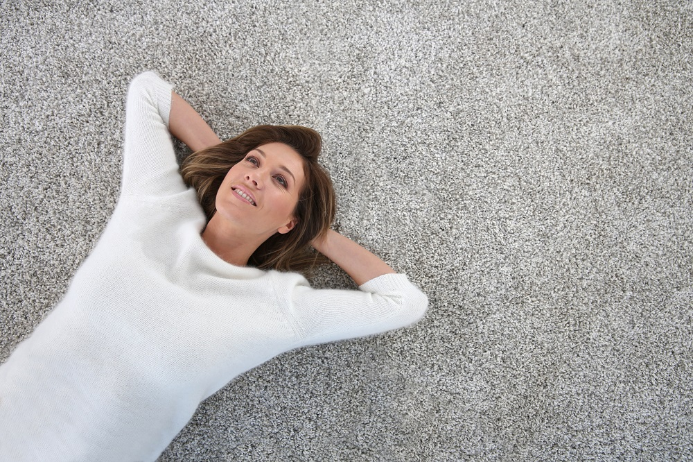 woman laying on clean carpet