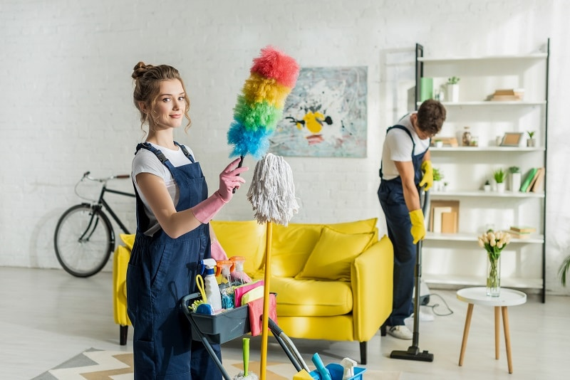 commercial vacuum buying guide - house cleaners dusting and  vacuuming